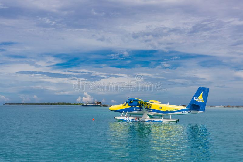 12.09.2015: Ari toll, Maldives: Seaplane landing in the ocean lagoon. The takeoff of a seaplane from the ocean beach royalty free stock images