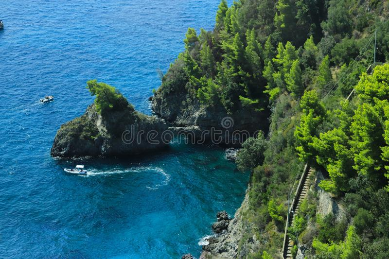 Blue waters and rocky cliffs of the Amalfi Coast royalty free stock photos