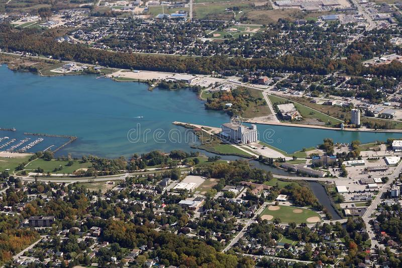 Arial view of the city of Owen Sound Ontario Canada October 5 2019. Looking down from small plane at blue water of Georgian Bay and grain elevators  houses and stock image