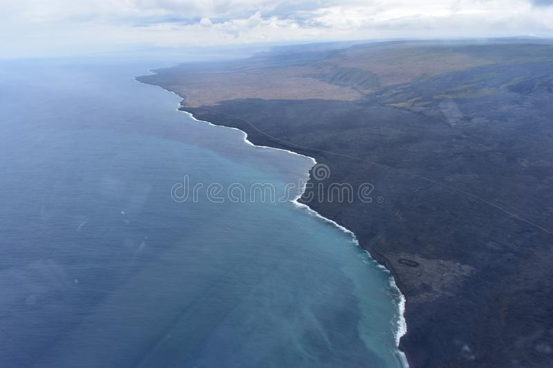 Arial view of Hawaii`s Kilauea volcano pouring into the Pacific Ocean stock photos