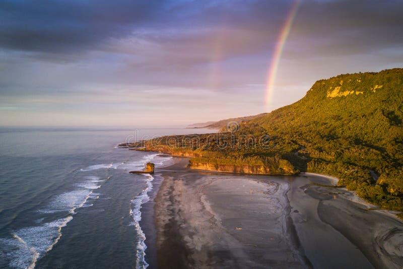Beautiful sunset at Punakaiki beach in New Zealand stock photos