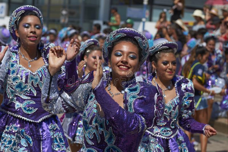 Arica Carnival in Chile, South America. Female members of a Caporales dance group in ornate costumes performing at the annual Carnaval Andino con la Fuerza del royalty free stock photography