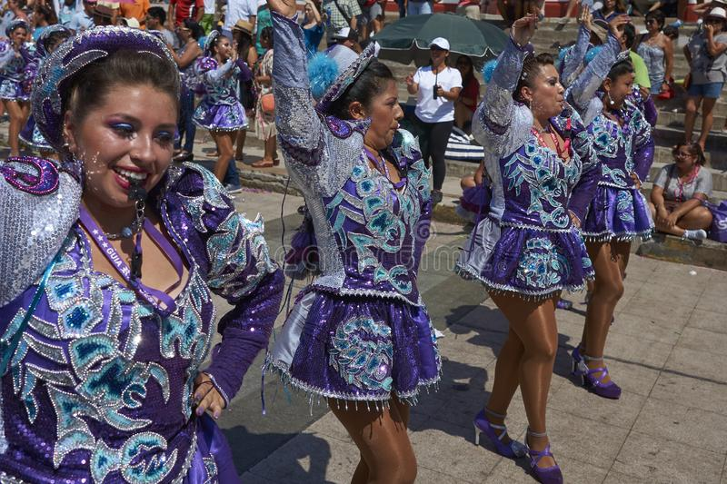 Arica Carnival in Chile, South America. Female members of a Caporales dance group in ornate costumes performing at the annual Carnaval Andino con la Fuerza del royalty free stock images