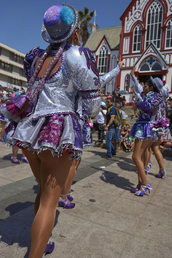 Arica Carnival in Chile, South America. Female members of a Caporales dance group in ornate costumes performing at the annual Carnaval Andino con la Fuerza del royalty free stock image