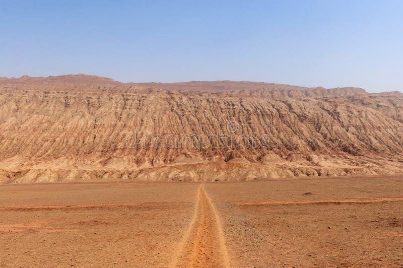 The arid landscape at the Flaming Mountains near the city of Turpan, Xinjiang. China royalty free stock image