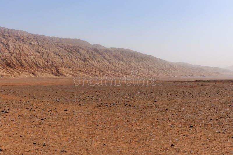 The arid landscape at the Flaming Mountains near the city of Turpan, Xinjiang. China stock photo