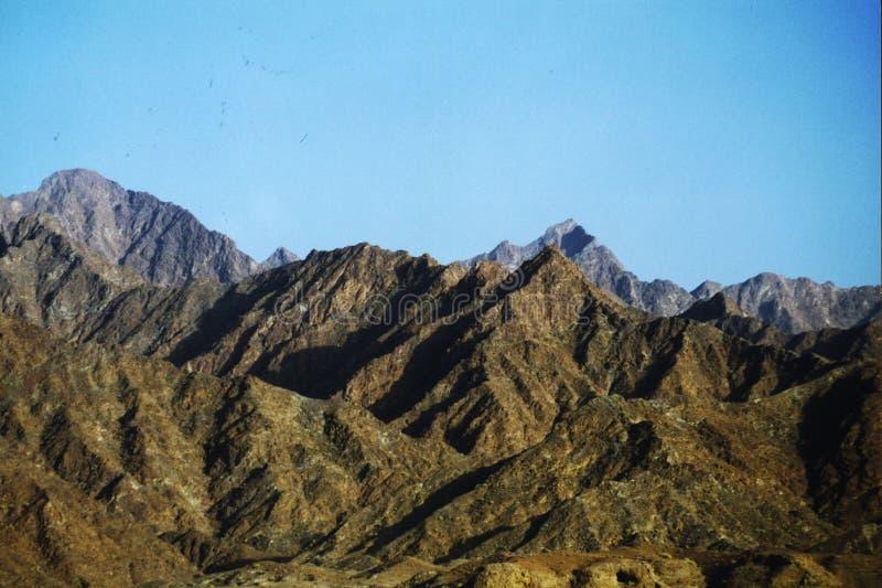 Arid Mountains in Dubai. Arid mountains in the heart of Dubai desert in UAE stock images