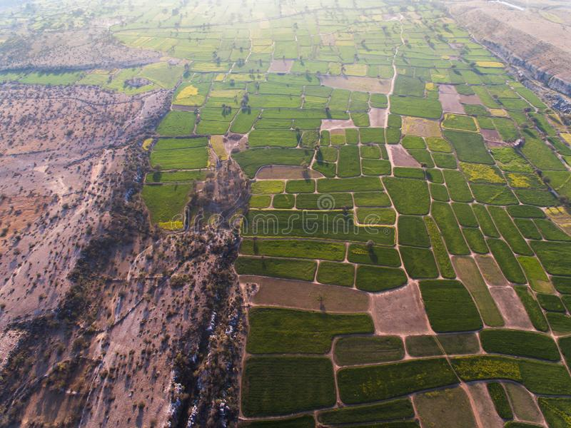 Ariel view of Farm lands and rocky area. Farm lands rocky area plateau pattern agri agriculture eco wheat crop mustard field farmer fields drone ariel view stock photography