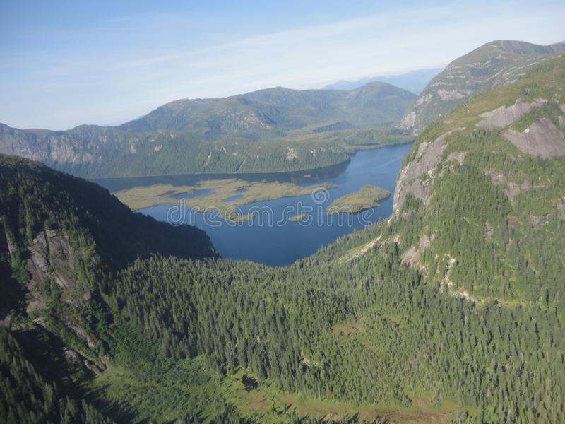 Ariel View of Misty Fjords in Ketchikan Alaska Tongass National Forest. Dense forests with small and large lakes strewn among the trees and up the mountains stock images