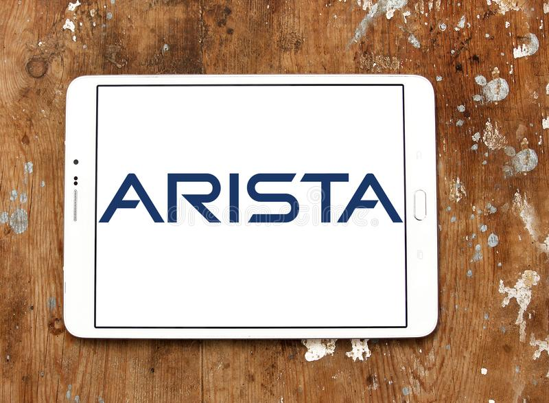 Arista Networks logo. Logo of Arista Networks on samsung tablet on wooden background. Arista Networks is a computer networking company, that designs and sells stock photos