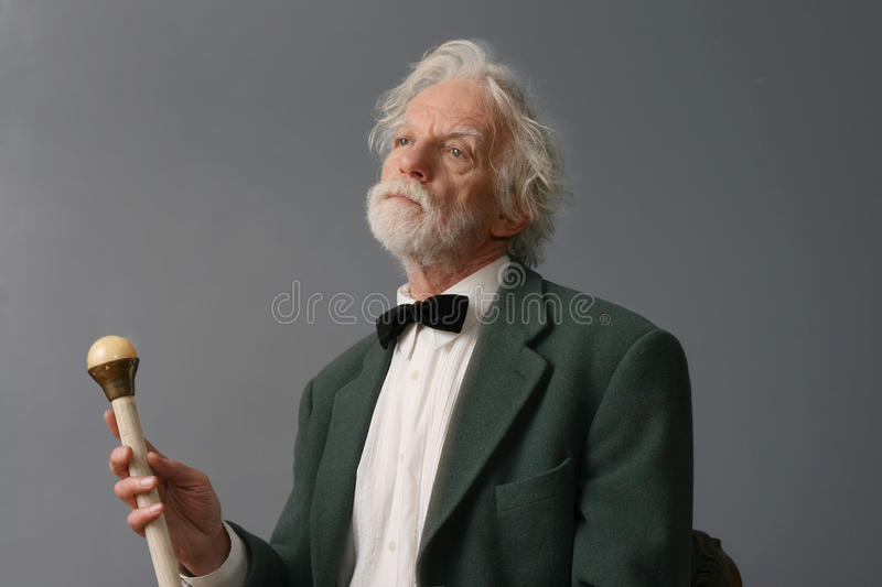 Aristocratic aged man with stick royalty free stock photography