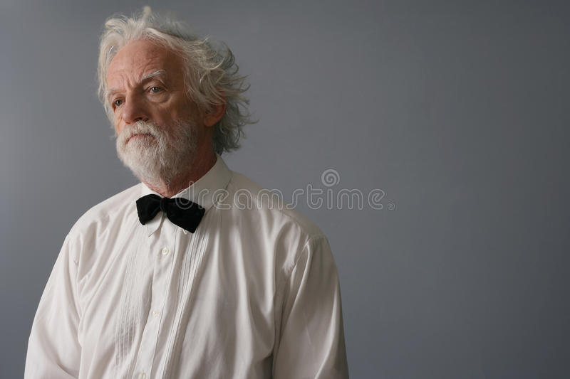 Aristocratic aged man with white shirt and butterf stock image