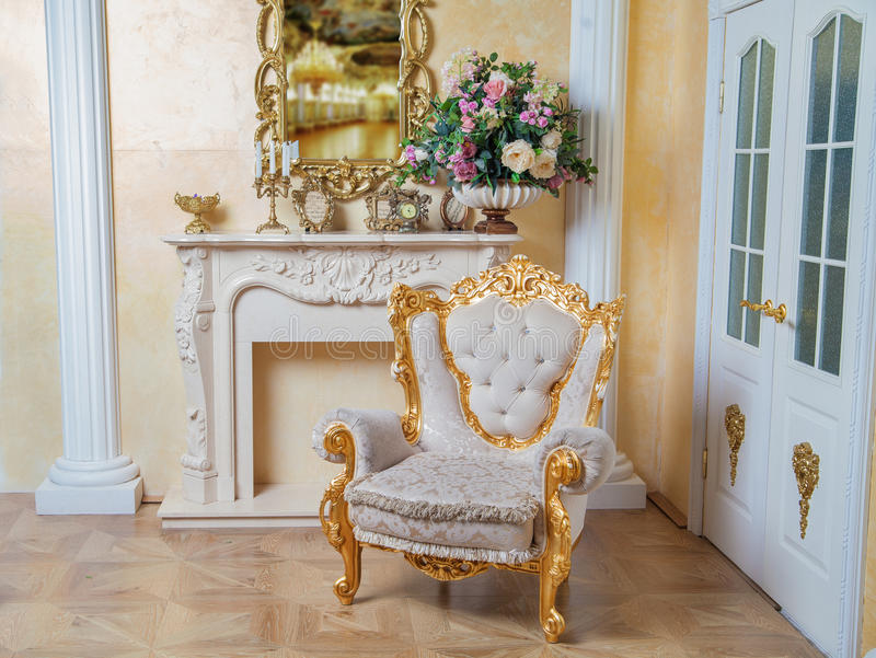 Aristocratic apartment interior in classic style. Luxurious antique interior in aristocratic style royalty free stock images