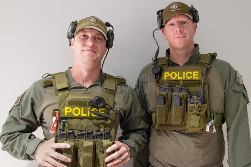 Arizona Armed Police Event Security. Armed security and safety police were evident at the Monster Energy NASCAR Cup Series race held at ISM Raceway in Phoenix stock photography