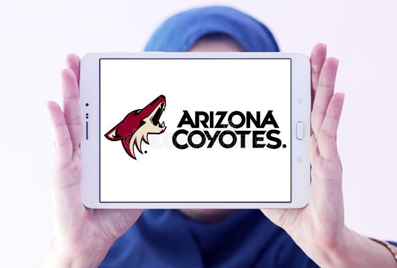 Arizona Coyotes ice hockey team logo. Logo of Arizona Coyotes team on samsung tablet holded by arab muslim woman. The Arizona Coyotes are a professional ice royalty free stock photos