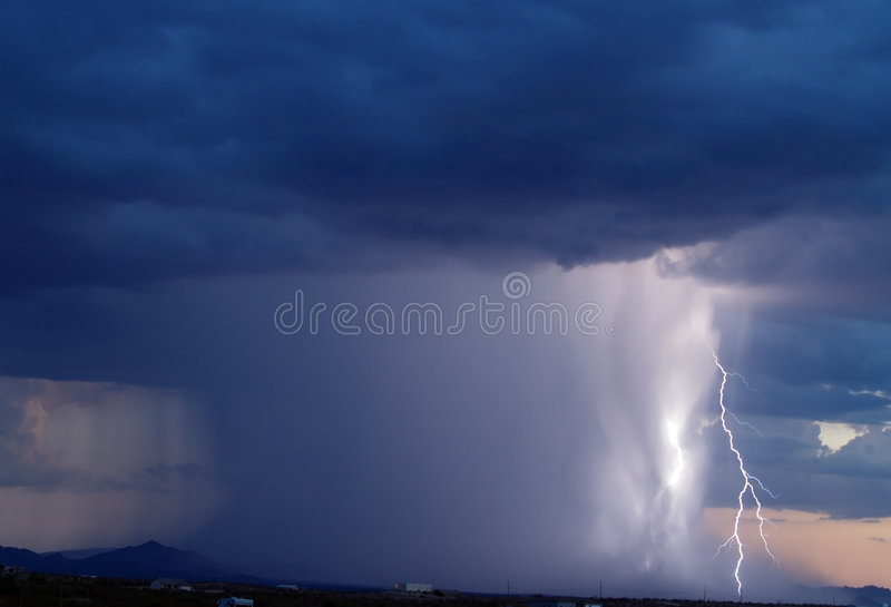 Arizona Monsoon Storm 2006. A late day Arizona Monsoon storm with lightning striking a power pole in the distance stock photo