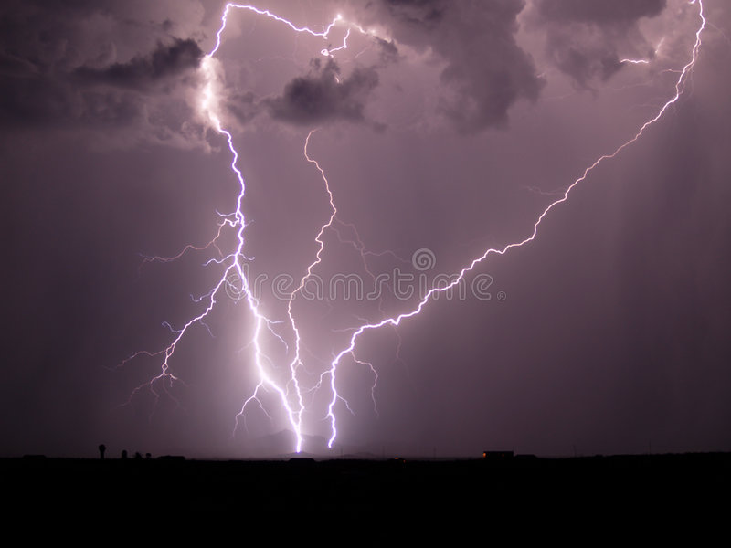Arizona Monsoon Storm 2006. A late night Arizona Monsoon storm where three lightning bolts are converging in the Gila Bend mountains stock photography