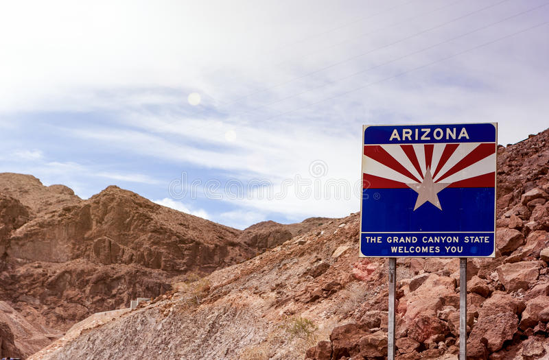 Arizona State Border Highway Sign Against Sky Blue Background. L royalty free stock photos