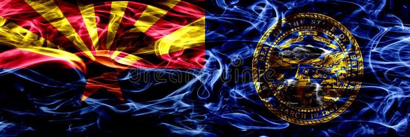 Arizona versus zij aan zij geplaatste vlaggen van de het conceptenrook van Nebraska de kleurrijke stock afbeelding