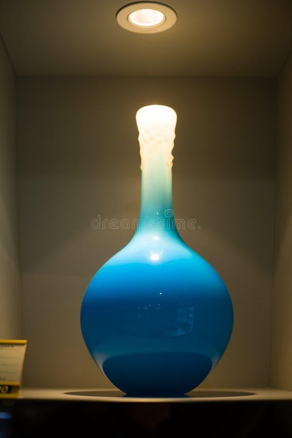 Blue glass bottle. Ark blue glass bottles in the exhibitionn royalty free stock image