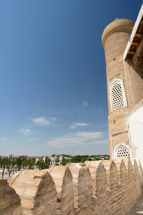 Side view of the portal tower. The Ark. Bukhara. Uzbekistan. The Ark of Bukhara is a massive fortress located in the city of Bukhara royalty free stock photography