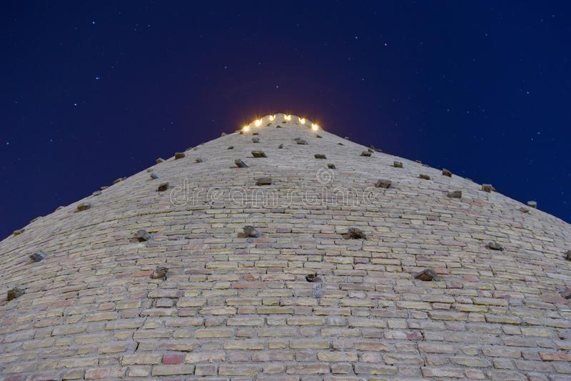 Ark Fortress Walls. Walls of Ark Fortress of Bukhara, Uzbekistan. View from bottom. Night photo shoot stock images