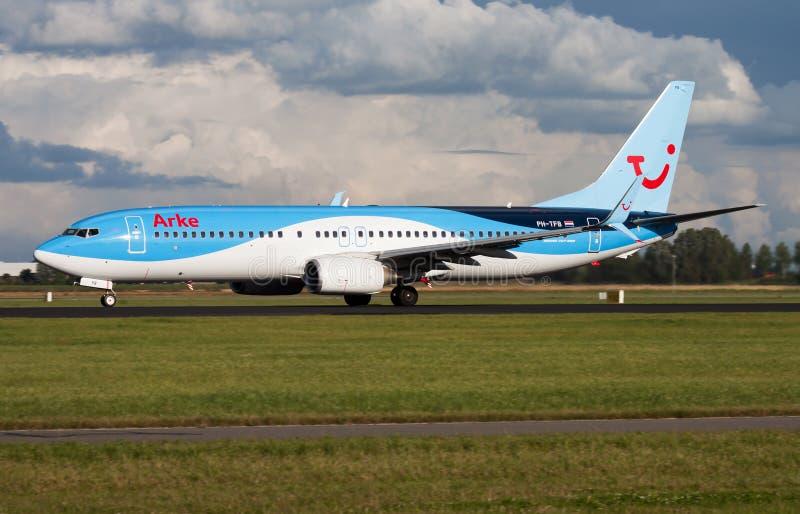 Arkefly TUI Boeing 737-800 PH-TFB passenger plane departure at Amsterdam Schipol Airport royalty free stock photos