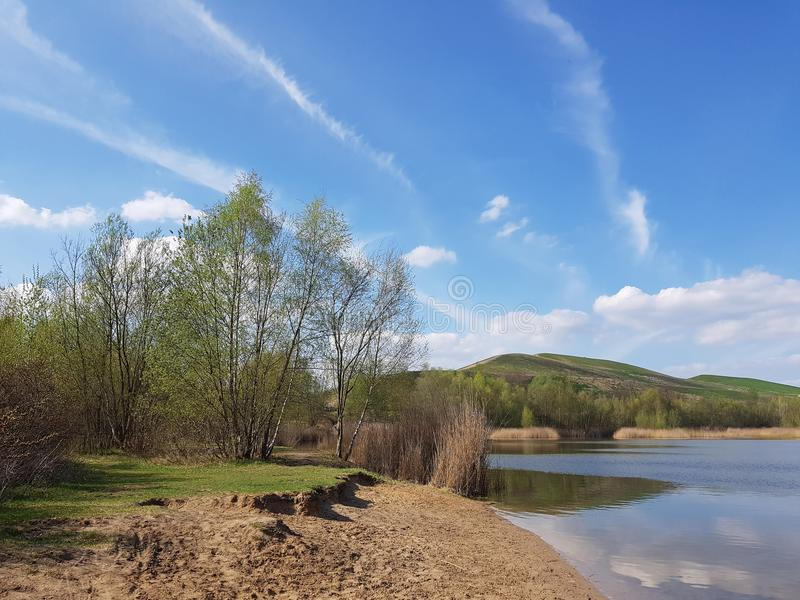 At the Arkenberge hills in Berlin in spring. The Arkenberge in Blankenfelde in the north of Berlin was originally a natural range of hills. By raise of rubble stock photo