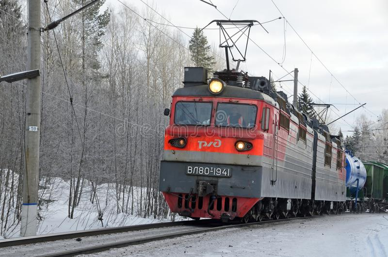 Arkhangelsk region, Russia, February, 15, 2018. Freight train moving by rail in winter, Russia, Arkhangelsk region stock image