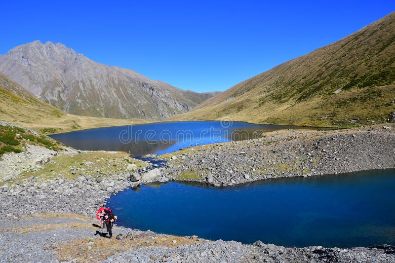 Arkhyz, Russia, Caucasus, September, 20, 2018. Tourists hiking near lake Chilik in clear weather. Russia, Arkhyz stock image