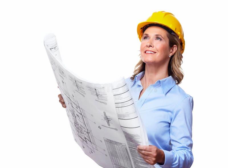 Arkitektkvinna med ett plan. royaltyfria bilder