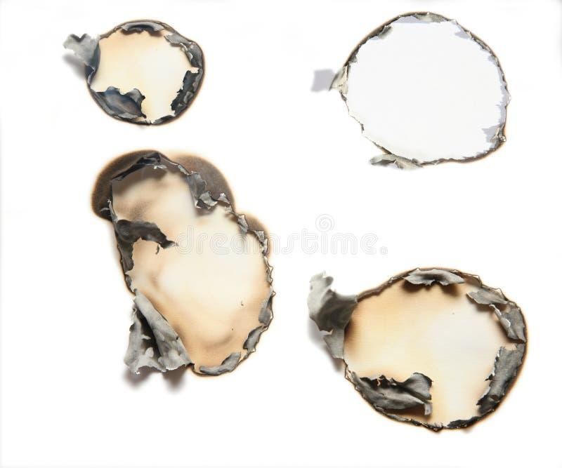 arkusz papieru spalone dziura obrazy stock