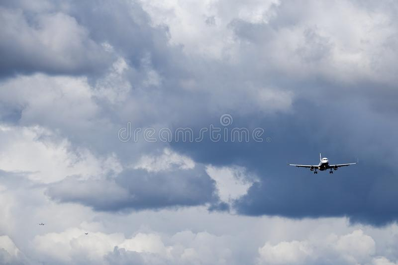 British Airways, BA, Airbus A320 - 232. Arlanda, Stockholm, Sweden - April 27, 2018: British Airways, BA, Airbus A320-232 fly ahead in dark sky with two other stock photo