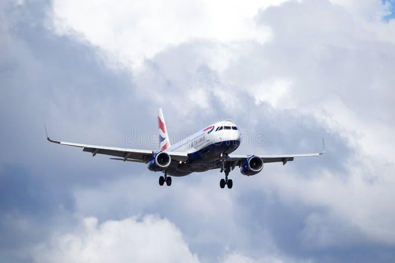 British Airways, BA, Airbus A320 - 232. Arlanda, Stockholm, Sweden - April 27, 2018: British Airways, BA, Airbus A320-232 fly by in dark sky, landing at royalty free stock photos