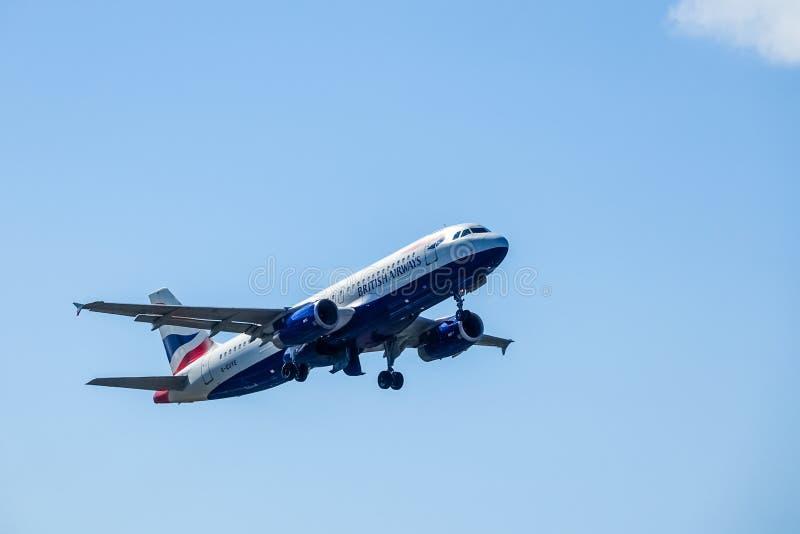 British Airways, BA, Airbus A320 - 232 take off in blue sky. Arlanda, Stockholm, Sweden - July 6, 2018: British Airways, BA, Airbus A320 - 232 take off in blue royalty free stock photo