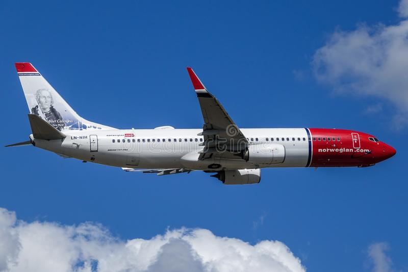 Norwegian Air Shuttle ASA, Boeing 737 - 800 take off. Arlanda, Stockholm, Sweden - July 10, 2018: Norwegian Air Shuttle ASA, Boeing 737 - 800 fly by in white royalty free stock photos