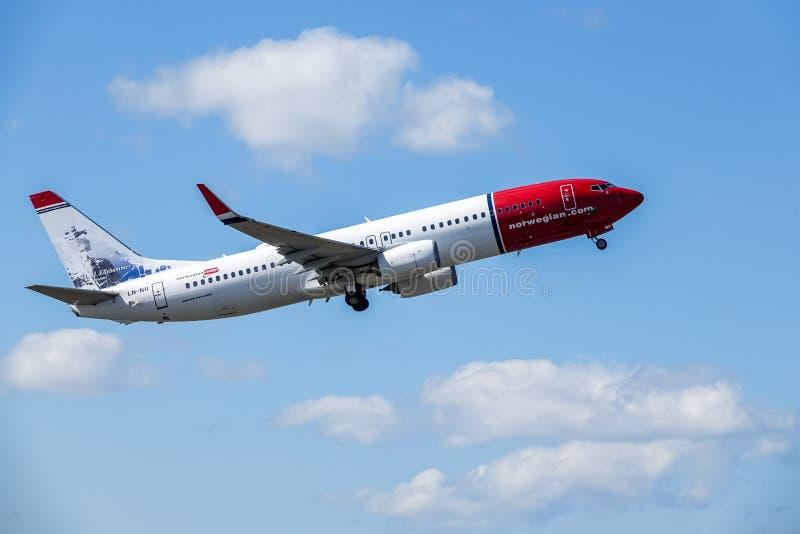 Norwegian Air Shuttle ASA, Boeing 737 - 800 take off. Arlanda, Stockholm, Sweden - July 6, 2018: Norwegian Air Shuttle ASA, Boeing 737 - 800 take off in white royalty free stock image