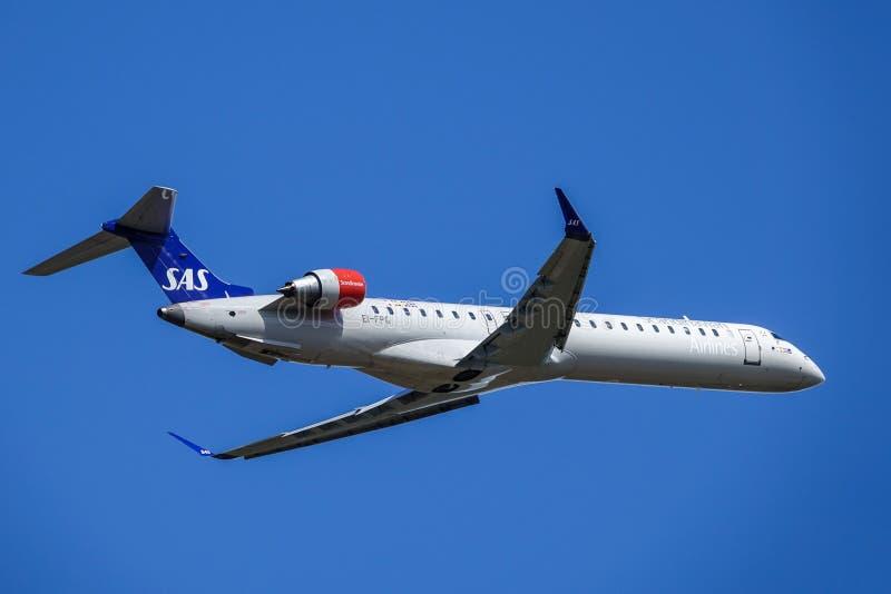 SAS Scandinavian Airlines, Bombardier CRJ - 900 take off royalty free stock image