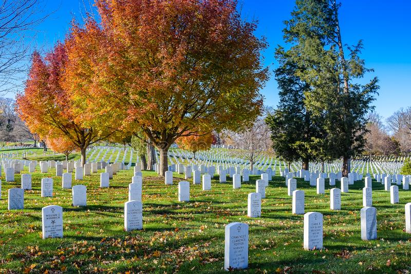 Arlington Cemetery on Fall Day. Arlington, VA/USA - December 04, 2015 - Field of headstones in Arlington Cemetery on a fall day stock images