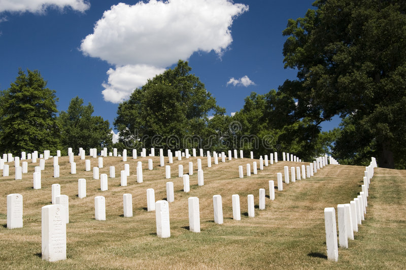 Arlington National Cemetery. Tombstone at Arlington National Cemetery in a sunny day with clouds - Washington D.C. 2007 stock images