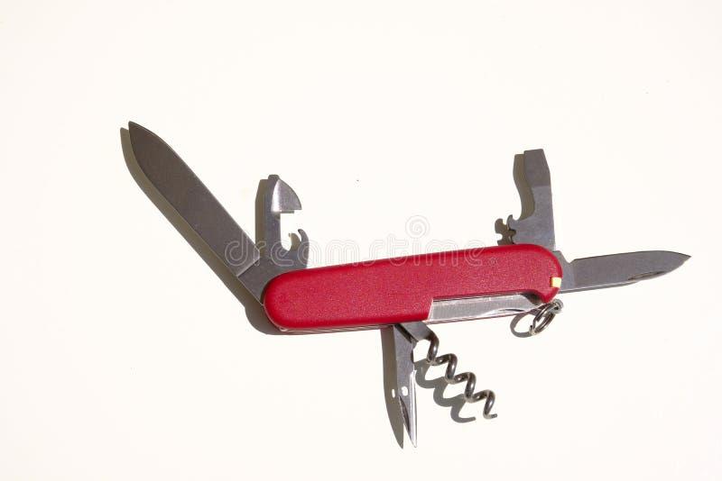 Armée suisse, rouge, outil de couteau de poche Modèle compact photos stock