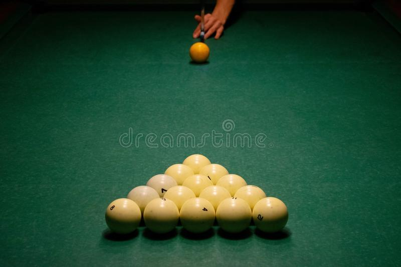 Billiard balls on a green pool table stock image
