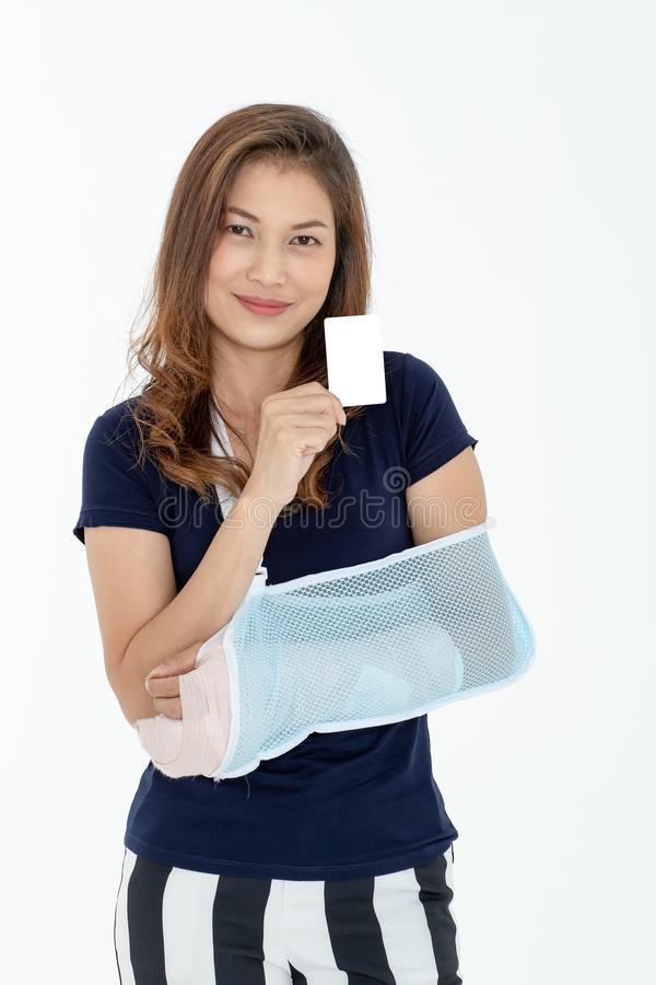 Arm broken beautiful Asian woman with arm sling showing credit c royalty free stock photo
