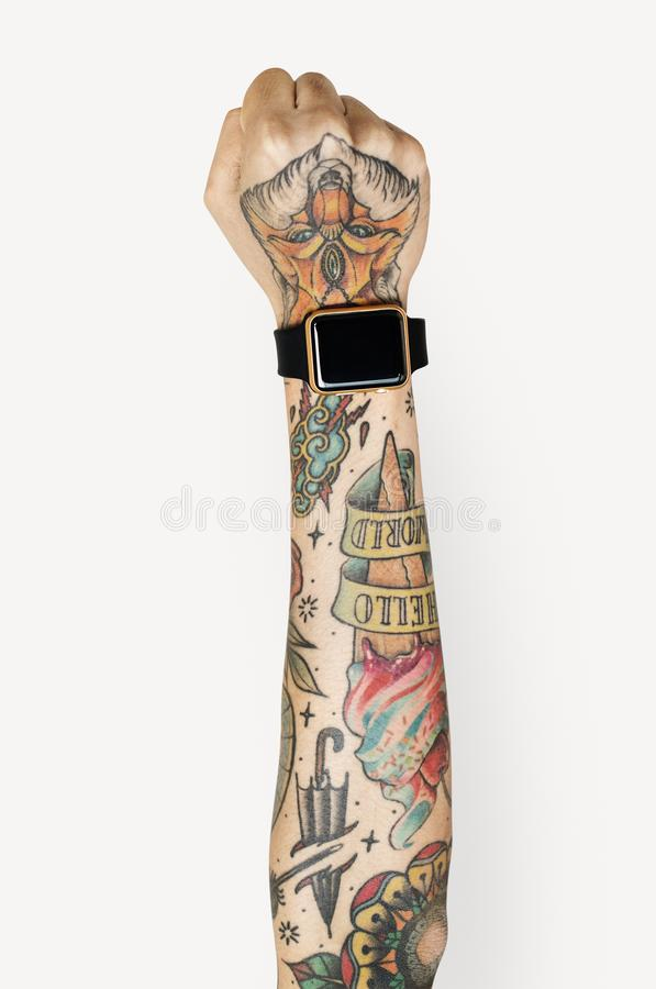 Arm fill with tattoos isolated. On white stock photography