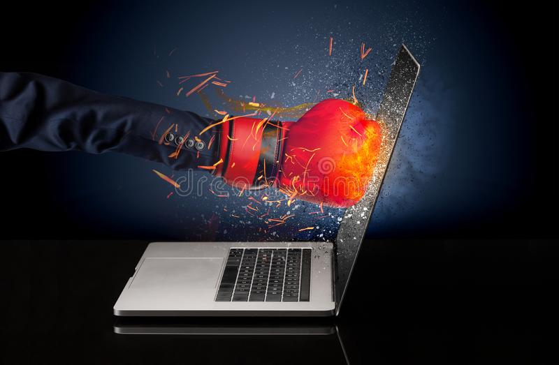 Arm hitting strongly laptop screen. Which breaks in little pieces stock photo