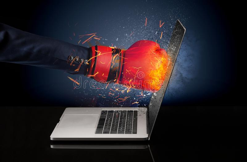 Arm hitting strongly laptop screen. Which breaks in little pieces royalty free stock image