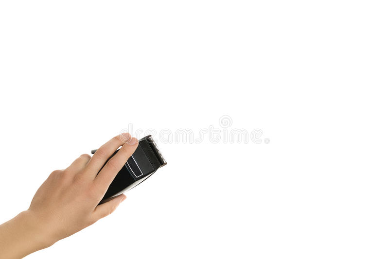 Arm holding hairclipper, isolated on white background royalty free stock photo