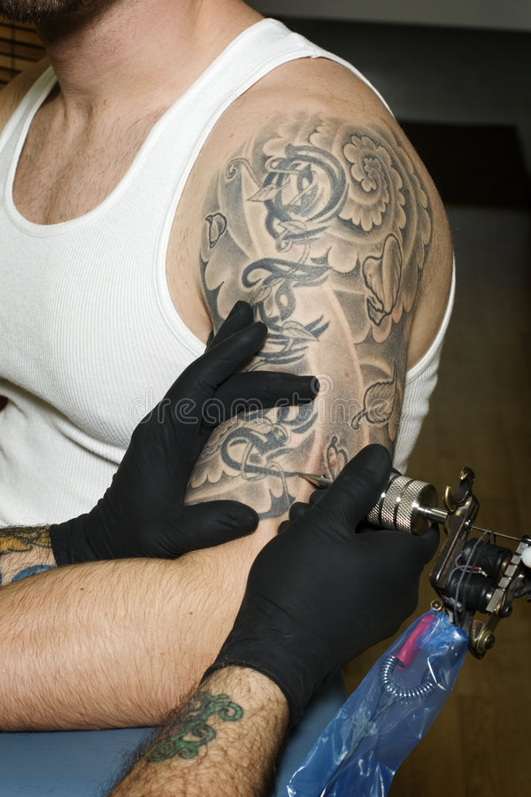 Arm Of Man Getting Tattooed Stock Photography