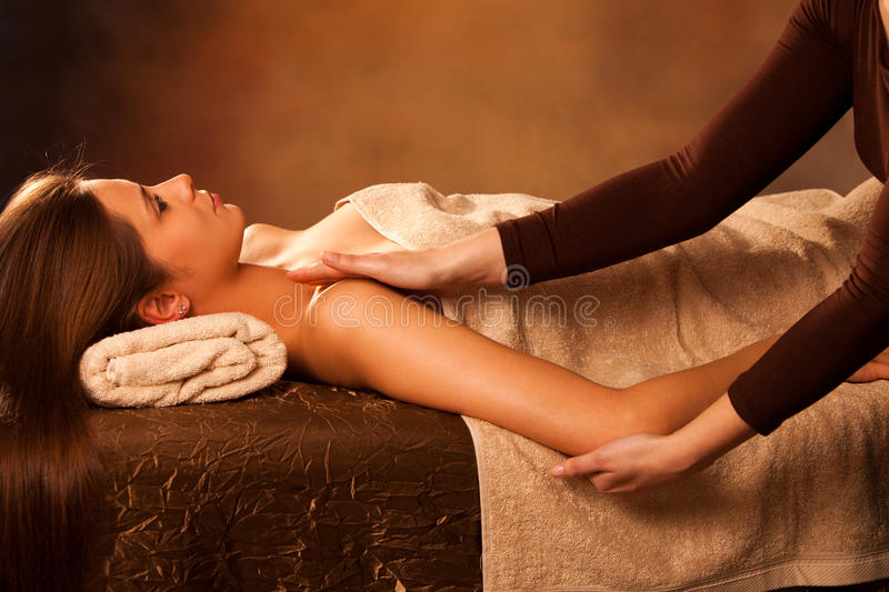 Arm massage. Woman enjoy in arm massage in spa royalty free stock image