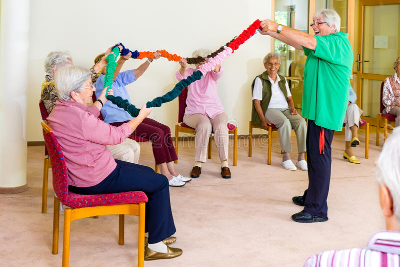 Arm mobility class with seniors royalty free stock photography